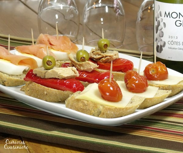 Fun, flavorful ingredients, piled high on a thick baguette slice make for unique appetizers or party food. | www.curiouscuisiniere.com