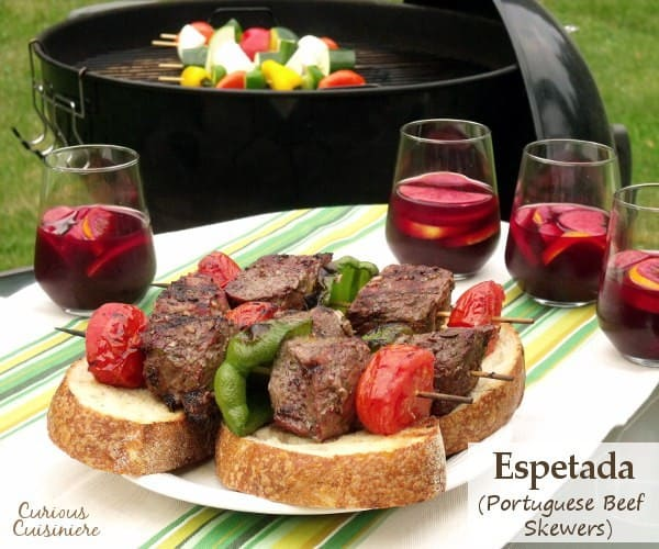 Tender, juicy grilled beef seasoned with garlic and bay, served over thick slices of crusty bread. Big, juicy grill-seared chunks of beef served over thick slices of artisan bread. Espetada, or Portuguese Beef Skewers, is the perfect summer party recipe. | www.CuriousCuisiniere.com