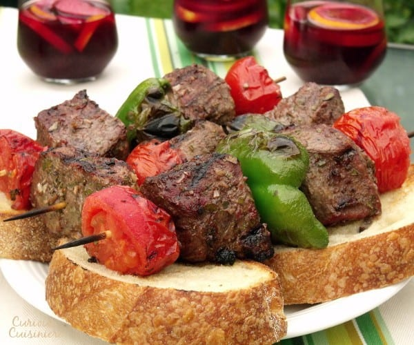 Tender, juicy grilled beef seasoned with garlic and bay, served over thick slices of crusty bread. The perfect summer party recipe.