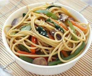Lo Mein is a classic Chinese takeout noodle dish that is quick and easy to make at home. This homemade vegetable lo mein is even more flavorful and definitely healthier than takeout! | www.CuriousCuisiniere.com