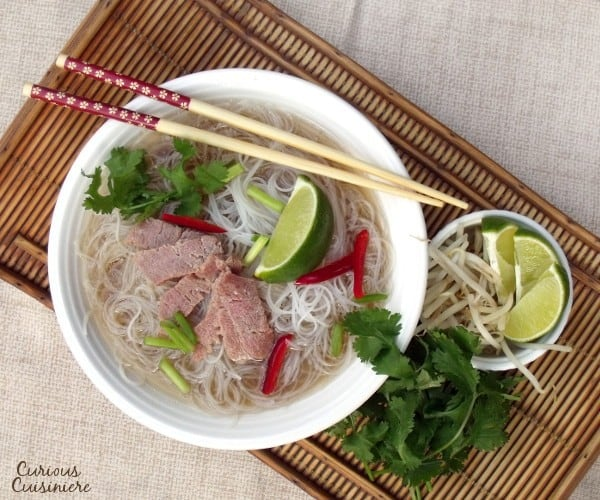 If you've never had Pho, think of it like beef noodle soup on some serious flavor steroids. This Crock Pot Pho recipe is an incredibly easy version of the classic, comforting Vietnamese soup. | www.CuriousCuisiniere.com