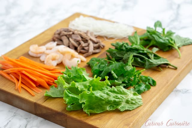 Filling ingredients for Vietnamese Fresh Spring Rolls on a cutting board