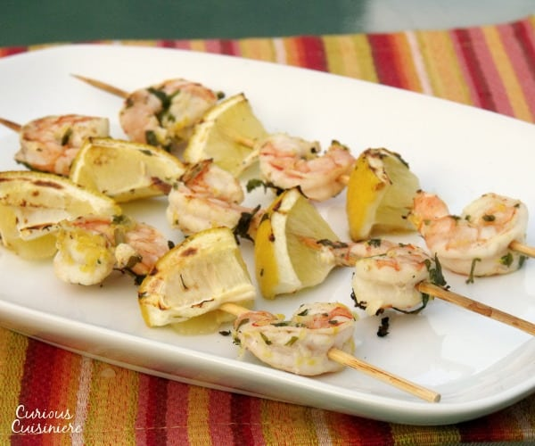 Lemon and parsley create the perfect bright marinade for these summery grilled shrimp. | www.curiouscuisiniere.com