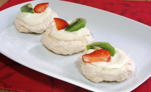 Light and airy, crisp on the outside and chewy at the center. Pavlova aren't just any meringue.   www.curiouscuisiniere.com