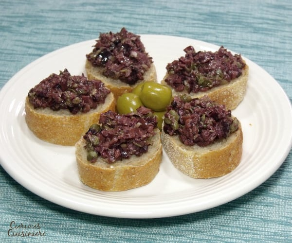 Bright olives and capers make up a flavorful South France olive tapenade. The perfect appetizer for your next party! | www.curiouscuisiniere.com