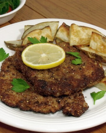 Breaded and pan fried pork chops make for a quick and easy German dinner. | www.curiouscuisiniere.com