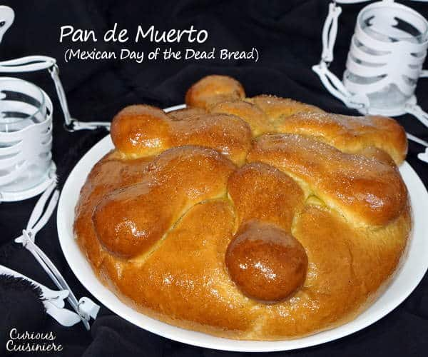 Pan de Muerto is a light and sweet Mexican Day of the Dead bread, traditionally spiced with ground anise and brushed with an orange glaze.
