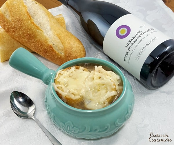 Comforting French Onion Soup combines caramelized onions, crisp toast, and gooey cheese for one comforting dish. | www.curiouscuisiniere.com