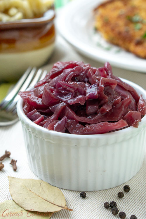 Blaukraut, German Red Cabbage, in a small bowl served with schnitzel and spaetzle.