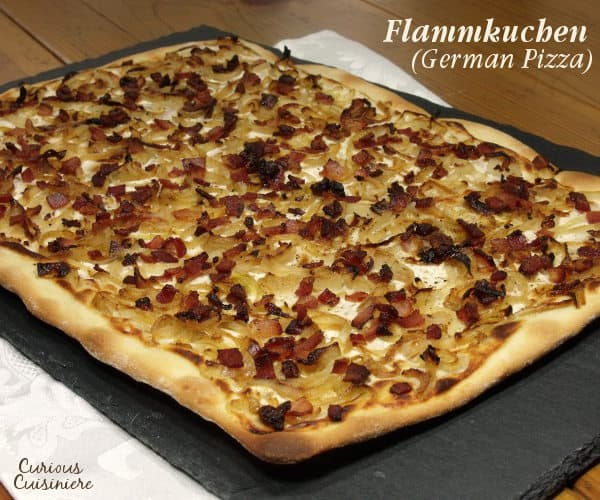 Bacon, caramelized onions, and a creamy base make up Flammkuchen, this classic German pizza, all on top of a cracker-thin, crispy crust. | www.curiouscuisiniere.com