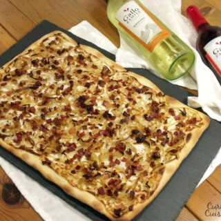 Bacon, caramelized onions, and a creamy base make up this classic German pizza, all on top of a cracker-thin, crispy crust. | www.curiouscuisiniere.com