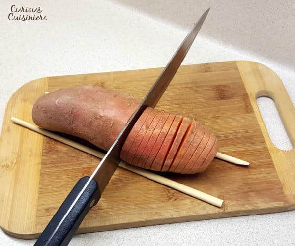 Hasselback sweet potatoes make for a beautifully presented holiday side dish. They're the perfect alternative to sweet potato casserole for your Thanksgiving table!   www.curiouscuisiniere.com