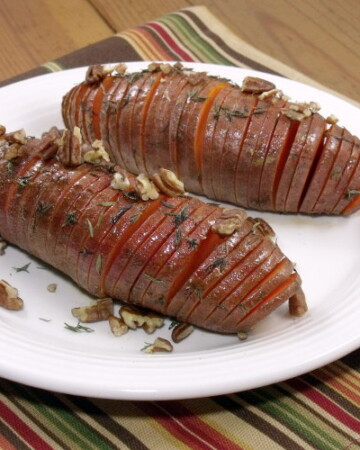Hasselback potatoes make for a beautifully presented holiday side dish, and using sweet potatoes makes them the perfect addition to any Thanksgiving table! | www.curiouscuisiniere.com