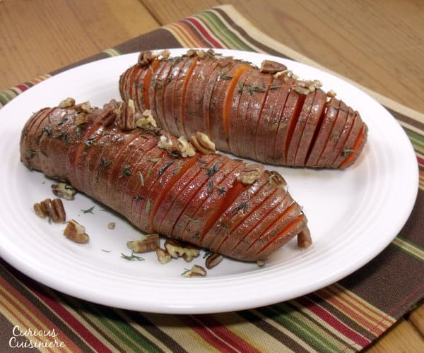 Hasselback sweet potatoes make for a beautifully presented holiday side dish. They're the perfect alternative to sweet potato casserole for your Thanksgiving table! | www.curiouscuisiniere.com