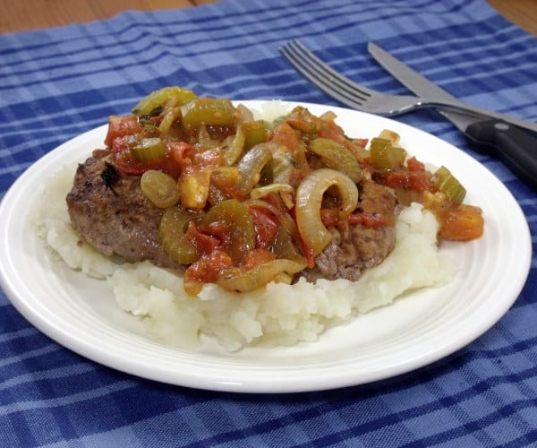 Comfort food that is quick enough for a weeknight, this Skillet Swiss Steak is full of veggies, for a healthy, easy meal.   www.curiouscuisiniere.com #WeekdaySupper #CertfiedAngusBeef