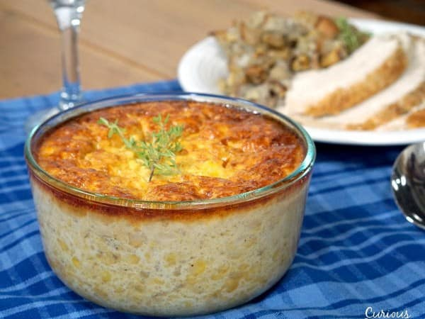 If you're sick of the same old corn side dish, try this recipe for Corn Pudding. This dish, with Native American origins is like a cross between creamed corn and a souffle. | www.curiouscuisiniere.com