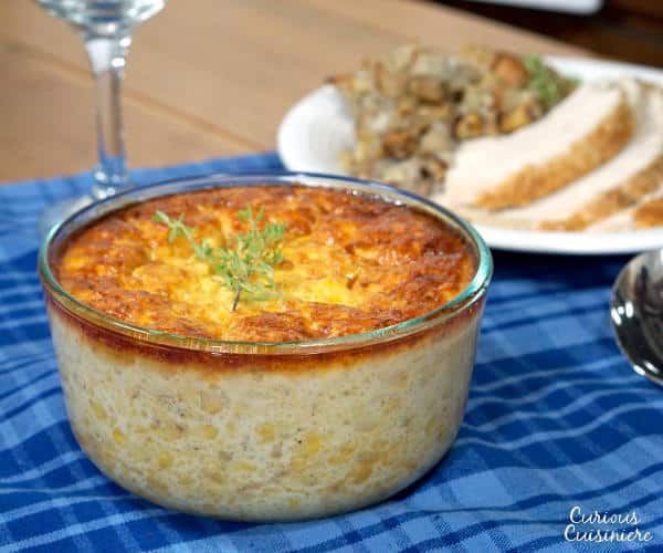 If you're sick of the same old corn side dish, try this recipe for Southern Corn Pudding. This dish, with Native American origins, is like a cross between creamed corn and an eggy custard. | www.curiouscuisiniere.com