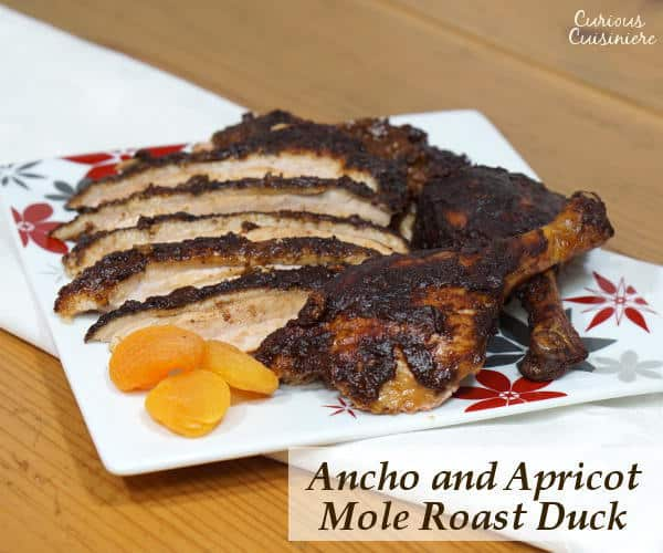 Change up your holiday dinner routine with this recipe for mole seasoned Roast Duck served with a rich Ancho and Apricot Mole Sauce. | www.curiouscuisiniere.com