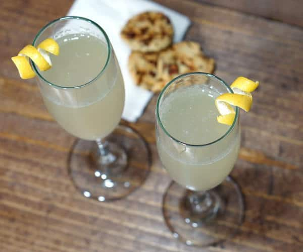 With a fun play of sweet, sour, and bubbles, this recipe for a French 75 cocktail is perfect for any celebration! | www.curiouscuisiniere.com