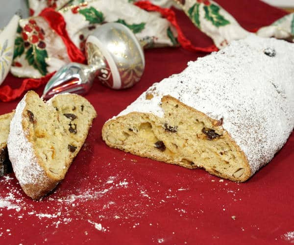 This recipe for rich, fruit-studded Stollen makes a festive and tasty Christmas bread, perfect for celebrating with family or bringing to a holiday party! | www.curiouscuisiniere.com