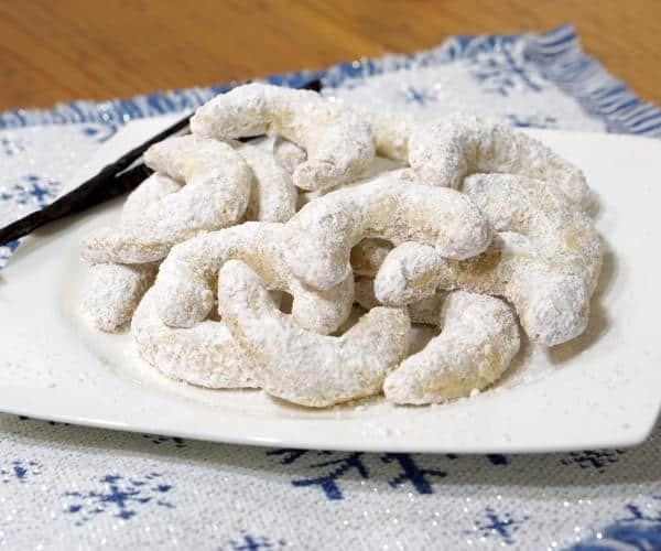 Crisp and buttery with a nutty, almond flavor, this recipe for delicate Vanillekipferl, or Austrian Vanilla Crescent Cookies, creates cookies that look pretty on a platter and are sure to be a hit at your holiday party. www.curiouscuisiniere.com
