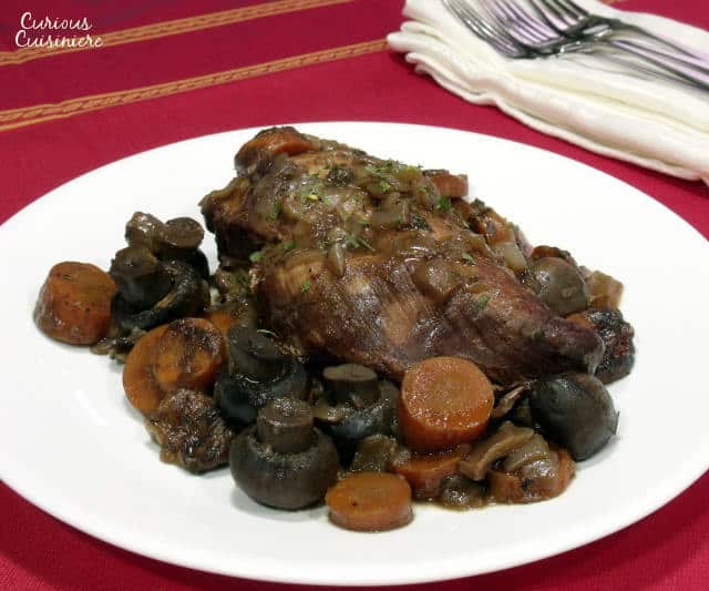 Coq Au Vin Slow Cooker style brings cook while-you're-away ease to the classic French wine braised chicken dish. | www.curiouscuisiniere.com