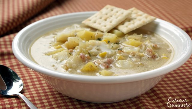 This recipe for New England Seafood Chowder createsa versatile and tasty soup, that is perfect for warming up on a cold winter day. Use whatever seafood you like to fit this chowder to your family's tastes. | www.CuriousCuisiniere.com