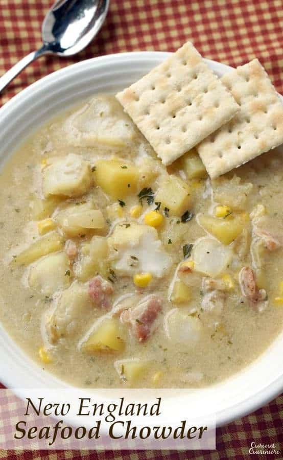 This recipe for New England Seafood Chowder creates a versatile and tasty soup, that is perfect for warming up on a cold winter day. Use whatever seafood you like to fit this chowder to your family's tastes. | www.CuriousCuisiniere.com