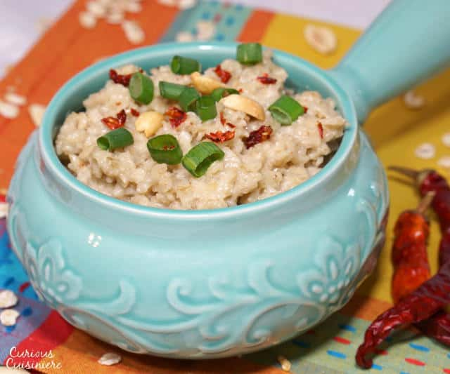 Morning oats don't have to be sweet, this Spicy Thai Peanut Savory Oatmeal Bowl brings savory Thai peanut flavors and a hint of spice together for a fun way to kick start your day. | www.CuriousCuisiniere.com