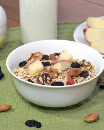 This Swiss Muesli Recipe brings protein-packed toasted, nutty goodness to breakfast. Serve it with a cup of milk and a hard boiled egg for a protein rich way to start our day.   www.CuriousCuisiniere.com