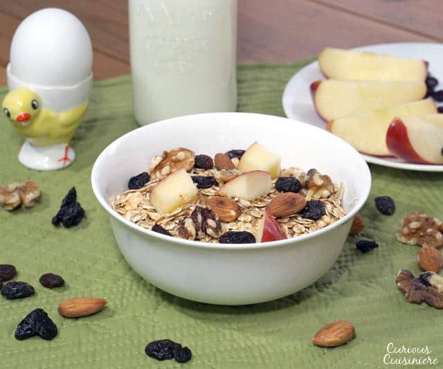 This Swiss Muesli Recipe brings protein-packed toasted, nutty goodness to breakfast. Serve it with a cup of milk and a hard boiled egg for a protein rich way to start your day. | www.CuriousCuisiniere.com