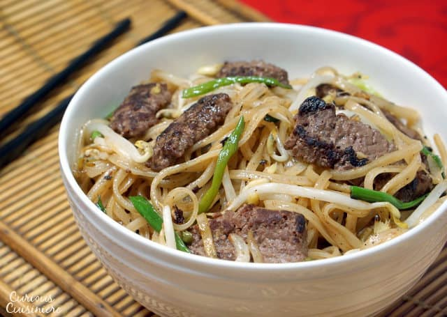Beef Chow Fun is a Cantonese stir fry recipe using rice noodles, beef, and bean sprouts. You don't need to order takeout to have this easy, flavorful dinner! | www.CuriousCuisiniere.com