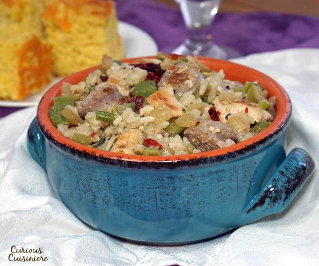 Cajun Chicken and Sausage Jambalaya is a smoky and flavorful one pot meal. Whether you like it spicy or mild, this recipe is sure to a favorite for family dinners and parties. | www.CuriousCuisiniere.com
