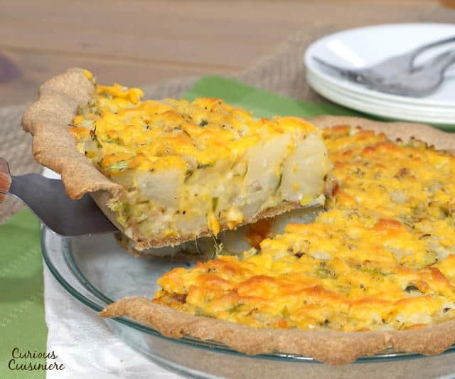 British Homity Pie brings the cheesy potato goodness of a loaded baked potato together with a hearty whole wheat crust. It is the perfect recipe for an easy, vegetarian dinner. | www.CuriousCuisiniere.com