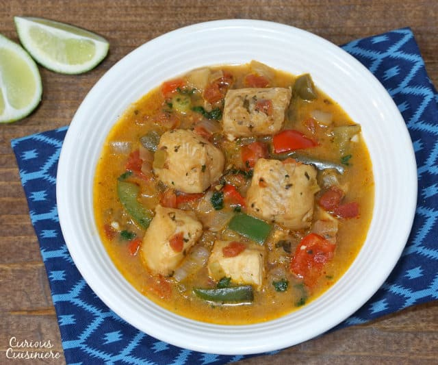 A light and tropical fish stew, Moqueca brings coconut milk and citrus together in a tasty Brazilian dinner recipe. | www.CuriousCuisiniere