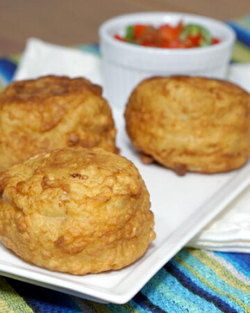 The Colombian version of Papas Rellenas stuffs a flavorful beef and rice mixture inside a creamy, mashed potato shell that is fried to golden brown. | www.CuriousCuisiniere.com