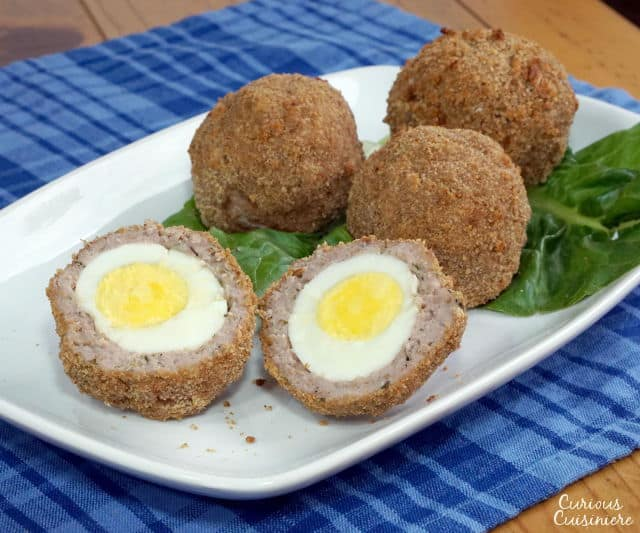 Avoid the deep fryer with these Baked Scotch Eggs, this easy recipe is perfect for a fun lunch or picnic. | www.CuriousCuisiniere.com