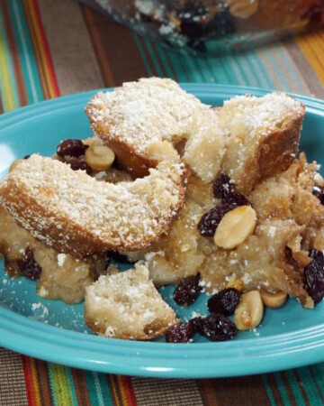 Capirotada is a Mexican Bread Pudding full of cinnamon, fruit, and nuts that is eaten during the religious season of Lent.   www.CuriousCuisiniere.com