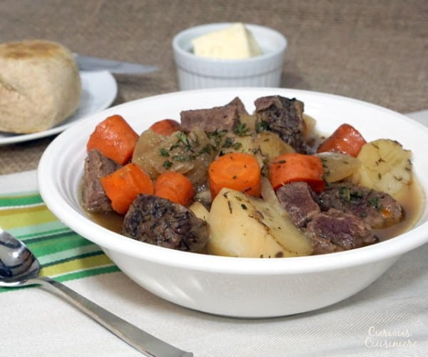 This slow cooker version of a Traditional Irish stew brings simple ingredients together to create an incredibly comforting recipe. | www.CuriousCuisiniere.com