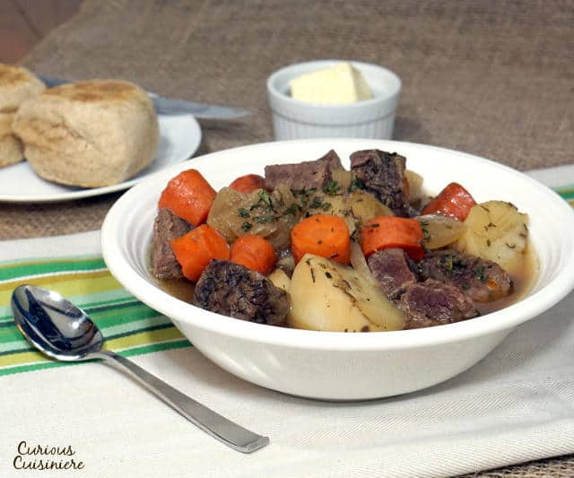 This slow cooker Irish Beef Stew recipe brings simple, traditional ingredients together to create an incredibly comforting meal. | www.CuriousCuisiniere.com
