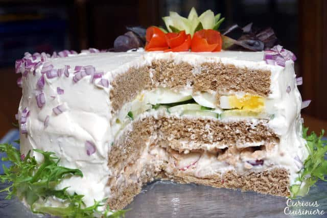 A Swedish Sandwich Cake is the perfect centerpiece for a spring party. Bright, fresh, and fun to prepare, make this recipe for your next picnic! | www.CuriousCuisiniere.com
