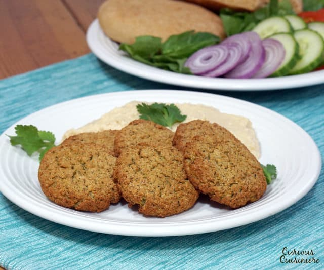Baked Falafel gives you all the healthy, nutty falafel goodness without the hassle or added fat of frying, and it's just as good for stuffing into a pita! | www.CuriousCuisiniere.com