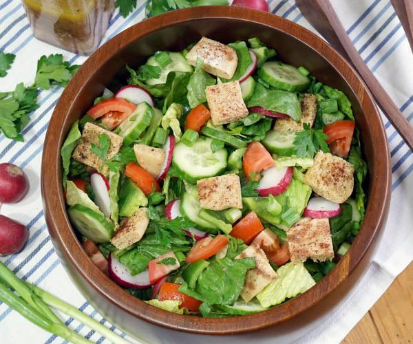 With toasted pita bread and a bright, lemony dressing, this crisp Fattoush Salad recipes is sure to bring a ray of sunshine to any spring or summer table. | www.CuriousCuisiniere.com