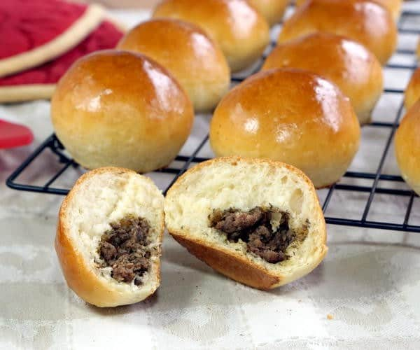 A soft and fluffy dinner roll stuffed with savory filling, Baked Russian Piroshki are the perfect portable meal. | www.CuriousCuisiniere.com