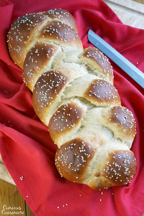Jewish braided bread, Challah, is light and fluffy egg bread with a glowing crust. It is perfect for special celebrations, weeknight dinners, and everything in between. | www.CuriousCuisiniiere.com