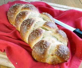 The Jewish braided bread, Challah, is light and fluffy egg bread with a glowing crust. It is perfect for special celebrations, weeknight dinners, and everything in between. | www.CuriousCuisiniiere.com