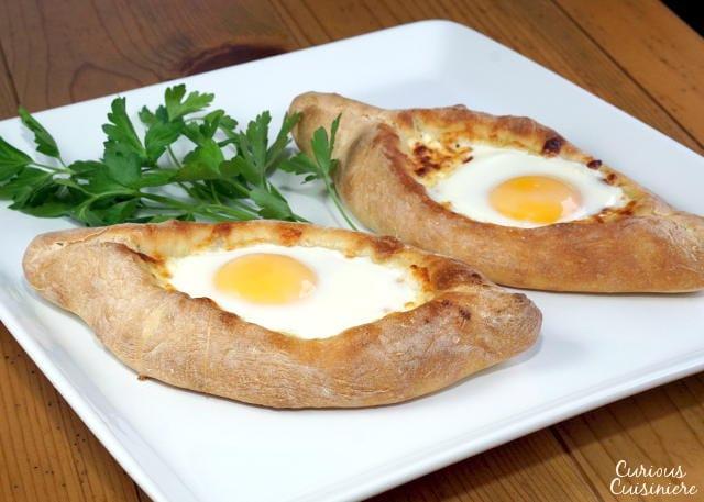 Adjaruli Khachapuri (Georgian Cheese Bread) on a large white platter