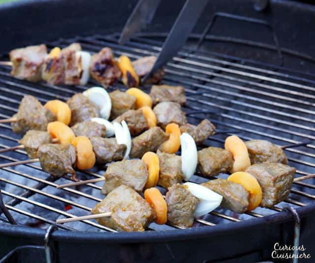 Sosaties are South African kebabs marinated in a sweet curry sauce. Our beef version is tender, lightly caramelized, and everything you want in a summer barbecue recipe. Perfectly paired with a South African Pinotage wine. | www.CuriousCuisiniere.com