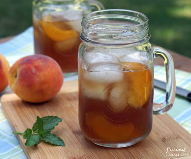 This lightly sweet Vietnamese Peach Tea is made with real peaches for a perfectly refreshing summer drink! | www.CuriousCuisiniere.com