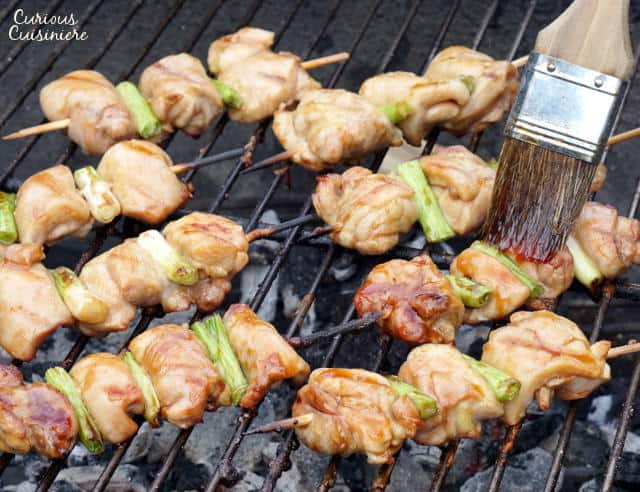 Negima Yakitori are tender and juicy Japanese chicken skewers that feature a sweet and salty glaze and are grilled to perfection. Get ready to kick your next backyard BBQ up a notch! | www.Curious Cuisiniere.com